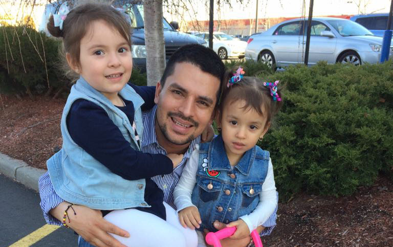 In this undated family photo provided by Sandra Chica, Pablo Villavicencio poses with his two daughters, Luciana, left, and Antonia. After Villavicencio couldn't produce a New York State Driver's License for identification, a guard at the Fort Hamilton in the Brooklyn borough of New York called Immigration and Customs Enforcement on him as he tried to deliver a pizza to the military base. Villavicencio was detained by military police and handed over to ICE pending removal from the country. (Villavicencio Family Photo via AP) .
