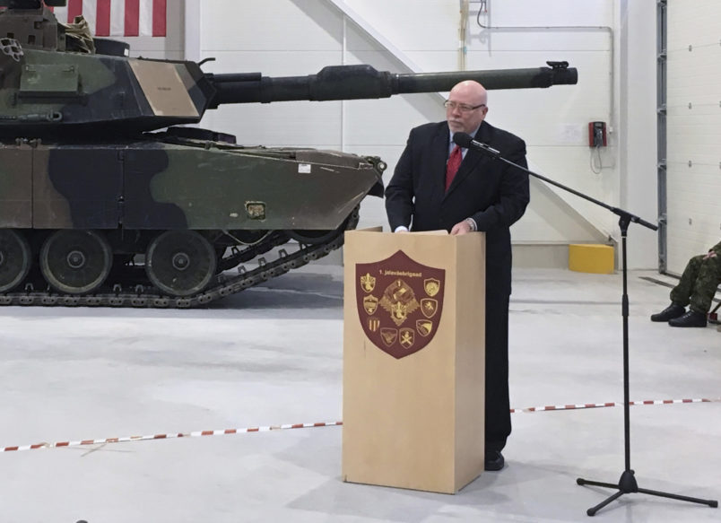 U.S. Ambassador to Estonia James D. Melville Jr. addresses dignitaries in front of an U.S. Army tank, at a hand-over ceremony of the upgraded NATO military base in Tapa, Estonia, Thursday, Dec. 15, 2016. The U.S. military has completed infrastructure investments worth $11.2 million to upgrade the Estonian army base as a part of a U.S. commitment to the alliance's eastern flank, which is facing increasing tensions with Russia. (AP Photo/Vitnija Saldava)
