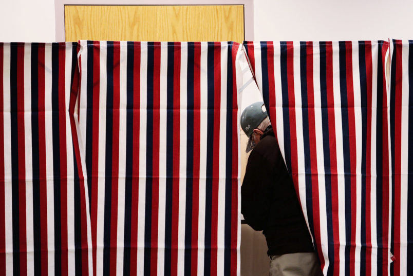 MANCHESTER, NH - JANUARY 08:  A man marks his ballot in a voting booth January 8, 2008 in Manchester, New Hampshire.  Record turnout for the nation's first primary was expected.  (Photo by Chris Hondros/Getty Images)