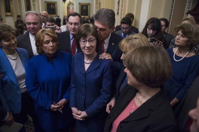 UNITED STATES - JANUARY 22: A bipartisan group of Senators hold a new conference in the Capitol after they voted to end debate on a continuing resolution to reopen the government on January 22, 2018. Appearing are, from left, Sens. Jeanne Shaheen, D-N.H., Tim Kaine, D-Va., Heidi Heitkamp, D-N.D., Joe Donnelly, D-Ind., Susan Collins, R-Maine, Joe Manchin, D-W.Va., Maggie Hassan, D-N.H., Amy Klobuchar, D-Minn., and Lisa Murkowski, R-Alaska. (Photo By Tom Williams/CQ Roll Call)
