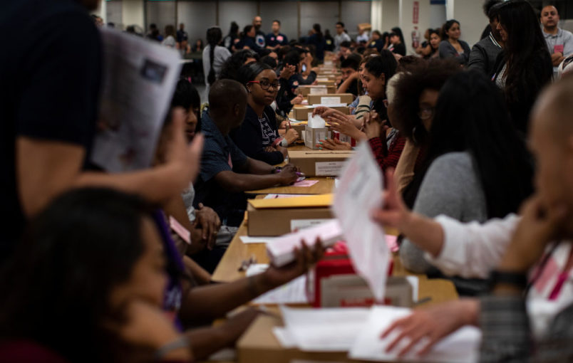NORWALK, CA - JUNE 5,  2018:  Ballot inspectors check ballots for any damage before they are counted at the LA County Registrar-Recorder office on June 5, 2018 in Norwalk, California.(Gina Ferazzi/Los AngelesTimes)