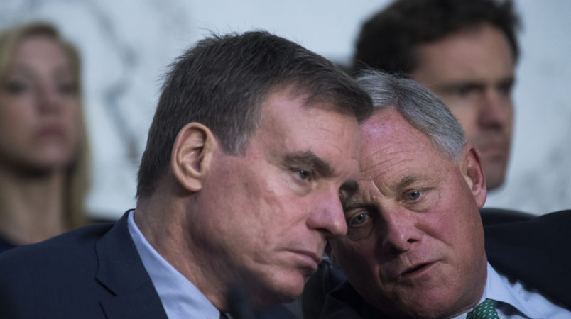"UNITED STATES - JUNE 20: Chairman Richard Burr, R-N.C., right, and Vice Chairman Mark Warner, D-Va., conduct a Senate (Select) Intelligence Committee hearing in Hart Building titled ""Policy Response to Russian Interference in the 2016 U.S. Elections,"" on June 20, 2018. Michael Daniel, former White House Cybersecurity Coordinator and Special Assistant to President Obama, and Amb. Victoria Nuland, former Assistant Secretary of State for European and Eurasian Affairs, testified. (Photo By Tom Williams/CQ Roll Call)"
