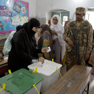 A Pakistani woman casts her vote at a polling station for the parliamentary elections in Rawalpindi, Pakistan, Wednesday, July 25, 2018. After an acrimonious campaign, polls opened in Pakistan on Wednesday to elect the country's third straight civilian election, a first for this majority Muslim nation that has been directly or indirectly ruled by its military for most of its 71-year history. (AP Photo/B.K. Bangash)