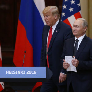 HELSINKI, FINLAND - JULY,16 (RUSSIA OUT) U.S.President Donald Trump (L) and  Russian President Vladimir Putin (R) enter the hall during their joint press conference in Helsinki, Finland, July,16,2018. Russian and U.S. Presidents have arrived to Helsinki for the summit. (Photo by Mikhail Svetlov/Getty Images)