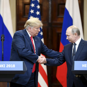 BEIJING, July 17, 2018  -- U.S. President Donald Trump (L) shakes hands with Russian President Vladimir Putin during a joint press conference in Helsinki, Finland, on July 16, 2018. (Xinhua/Lehtikuva/Jussi Nukari)