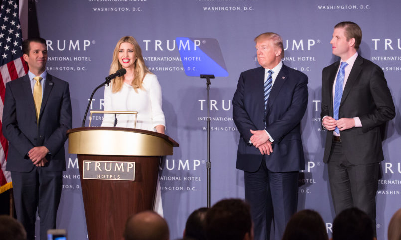 in the grand ballroom of Trump International Hotel, Ivanka Trump (center, speaking), with her family (l-r), Donald Trump Jr., U.S. Presidential candidate Donald J. Trump, and Eric Trump, talks about the grand opening of their latest property, Trump International Hotel - Old Post Office, in Washington, DC on October 26, 2016. The event was closed to the public, and included VIP guests and employees of Trump. (Photo by Cheriss May/NurPhoto)