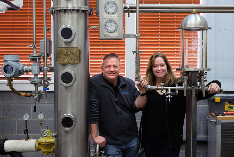 Afton, VA -  February 6:  Denver Riggleman and his wife Christine Riggleman stand by one of the stills at the Silverback Distillery they own in Afton, Va. Saturday, February 6, 2016.  They believe that the laws governing distilleries in Virginia are biased towards wineries and breweries which have a larger lobby and presence in the state.  (Photo by Norm Shafer/ For The Washington Post).