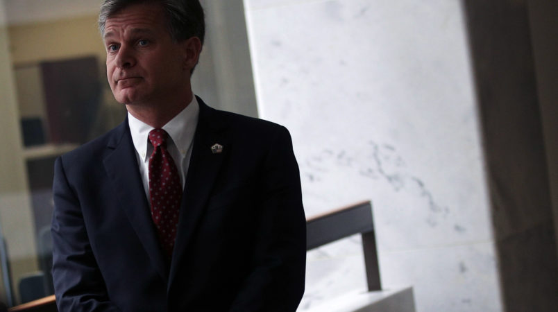 WASHINGTON, DC - JULY 13:  FBI Director nominee Christopher Wray waits in a hallway prior to his meeting with U.S. Sen. Mark Warner (D-VA) on Capitol Hill July 13, 2017 in Washington, DC. If confirmed, Wray will fill the position that has been left behind by former director James Comey who was fired by President Donald Trump about two months ago.  (Photo by Alex Wong/Getty Images)