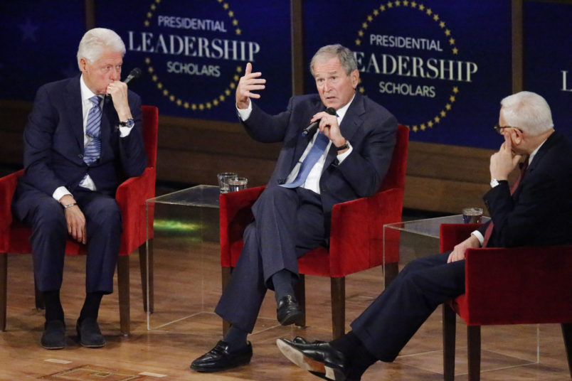 DALLAS, TX - JULY 13: Former president George W. Bush answers a question from moderator David Rubenstein (R) while former president Bill Clinton (L) looks on at the Presidential Leadership Scholars Graduation Ceremony at the George W. Bush Institue  on July 13, 2017 in Dallas, Texas. (Photo by Stewart  F. House/Getty Images)
