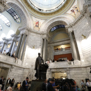 FRANKFORT, KY-AUGUST 30: African-American groups hold a rally at the Kentucky State Capitol building to urge Kentucky Governor Matt Bevin to remove a statue of Confederate President Jefferson Davis from the State Capitol rotunda August 30, 2017 in Frankfort Kentucky.  (Photo by Bill Pugliano/Getty Images)