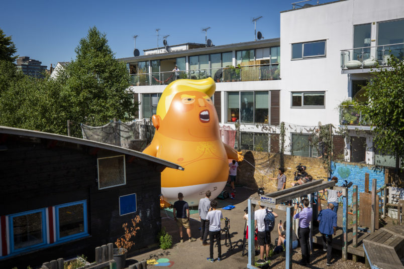 The Trump Baby sitting team give the six metre high inflatable TrumpBaby his first London outing inside the disused North London playground, Islington, London, United Kingdom. 26th June 2018. The plan, is to fly him above Parliament Square in Westminster when the real Trump, president of the United States arrives in the United Kingdom on the 13th of July 2018.  (photo by Andrew Aitchison / In pictures via Getty Images)
