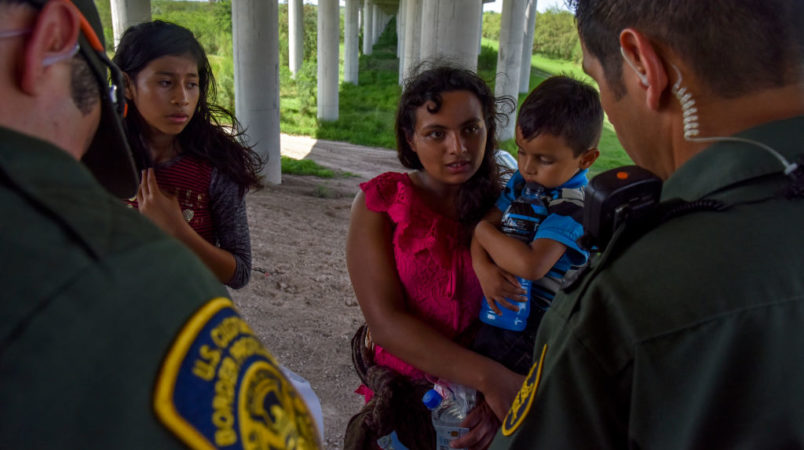 MISSION, TX - JUNE 27:Families from Guatemala are detained by United States Border Patrol agents for illegally crossing the U.S.-Mexico border along the Rio Grande on Wednesday, June 27, 2018, in Mission, TX. They ended up directly underneath a legal port of entry – Anzalduas International Bridge.(Photo by Jahi Chikwendiu/The Washington Post)