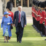 The Queen walks with President Trump as they inspect the Coldstream guards at Windsor castle.