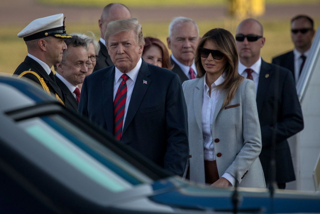 """HELSINKI, FINLAND - JULY 15:  U.S. President Donald Trump and First Lady, Melania Trump arrive aboard Air Force One at Helsinki International Airport  on July 15, 2018 in Helsinki, Finland.The President of the United States arrived in Helsinki, for talks with Russian President Vladimir Putin. President Trump said in a recent statement that he has """" low expectations"""" for the meeting, however he is under increasing pressure to confront the Russian President directly about special counsel Robert Mueller's indictment of twelve russian's said to have conspired to sway the decision of the 2016 US election.  (Photo by Chris McGrath/Getty Images) *** Local Caption *** Donald Trump; Melania Trump"""
