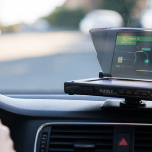 The Hudly Wireless Smart Driving Display and Hudly Lite keep your eyes on the road without losing track of your smartphone's navigation.