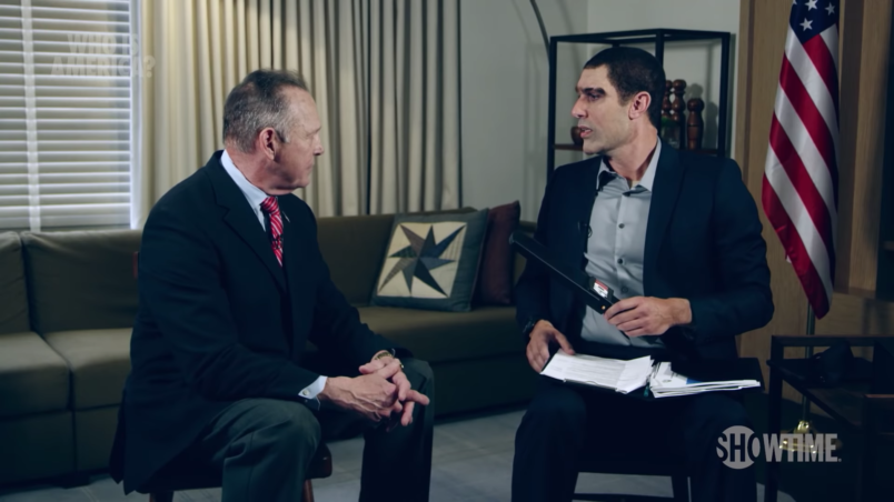 Sacha Baron Cohen demonstrates his pedophile-detecting wand on Roy Moore