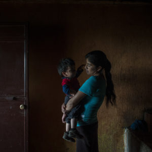 SAN RAFAEL LAS FLORES, GUATEMALA - JULY, 17: Elvia Mariela Marroquin, 31, who is Ervin's mother, hold her younger son Dylan, 2, inside the kitchen in her house in Las Nueces village, Santa Rosa.Otto Albizurez, 27, and his son Ervin, 10, left their home of Las Nueces village of San Rafael Las Flores, Santa Rosa, Guatemala, on Abril 28, 2018, heading to the USA. After three weeks travelling through Mexico, they were deteined in McAllen, Texas, by the border patrols. They were together for the first three day and than they were separated, detained in two different places. Otto spent 10 more days in a jail and than was deported to Guatemala. His son, Ervin is still in USA, in a shelter of Houston, Texas. (Photo by Daniele Volpe for The Washington Post)