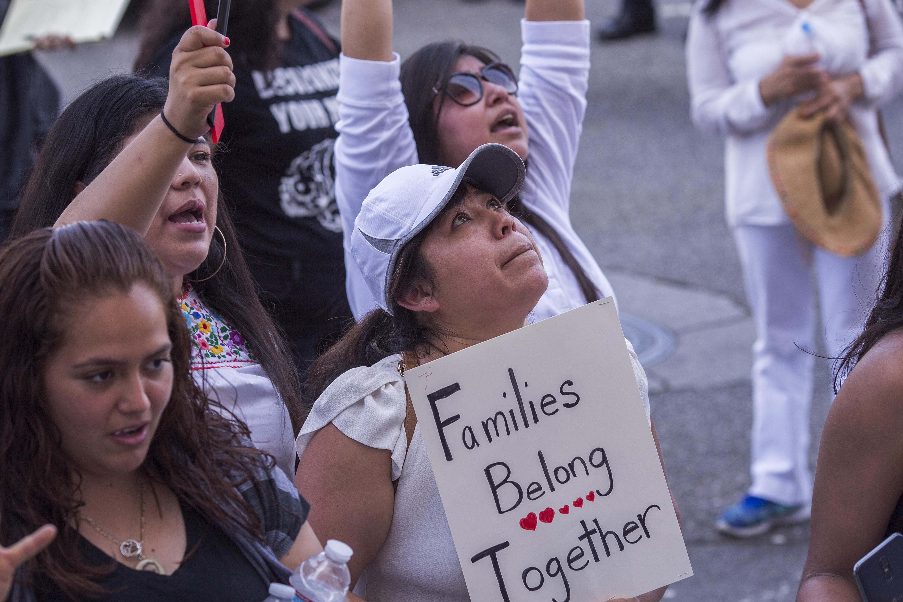 LOS ANGELES, CA - JUNE 30: People demonstrate and call out words of encouragement to immigrants held inside the Metropolitan Detention Center after marching to decry aggressive Trump administration immigration and refugee policies on June 30, 2018 in Los Angeles, California. Although President Trump was forced to reverse his policy of removing all children from their immigrant or asylum-seeking parents, little clarity appears to be seen as to how agencies can fulfill a court order to reunite thousands of children and parents detained far apart by multiple agencies. Yesterday, the Justice Department filed papers in a Los Angeles federal court to have families arrested for illegal border crossings incarcerated together indefinitely. The rally is one of more than 700 such protests being held throughout the nation.  (Photo by David McNew/Getty Images)
