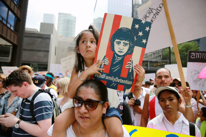 "CHICAGO, June 30, 2018 -- People participate in the ""Families Belong Together"" rally at Daley Plaza in Chicago, the United States, on June 30, 2018. Tens of thousands of Americans marched and rallied across the United States to protest the Trump administration's ""zero tolerance"" immigration policy resulting in over 2,000 children separated from their families who crossed the border illegally. (Xinhua/Wang Ping)"