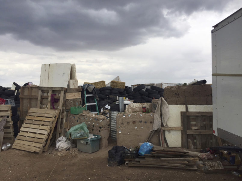 FILE - This Friday, Aug. 3, 2018, file photo released by Taos County Sheriff's Office shows a rural compound during an unsuccessful search for a missing 3-year-old boy in Amalia, N.M. Authorities say they've arrested three women believed to be the mothers of 11 children found living in filth in a makeshift compound in rural northern New Mexico. Taos County, New Mexico, Sheriff Jerry Hogrefe said Monday, Aug. 6, 2018, that the women and two men who were arrested over the weekend face charges of child abuse. (Taos County Sheriff's Office via AP,File)