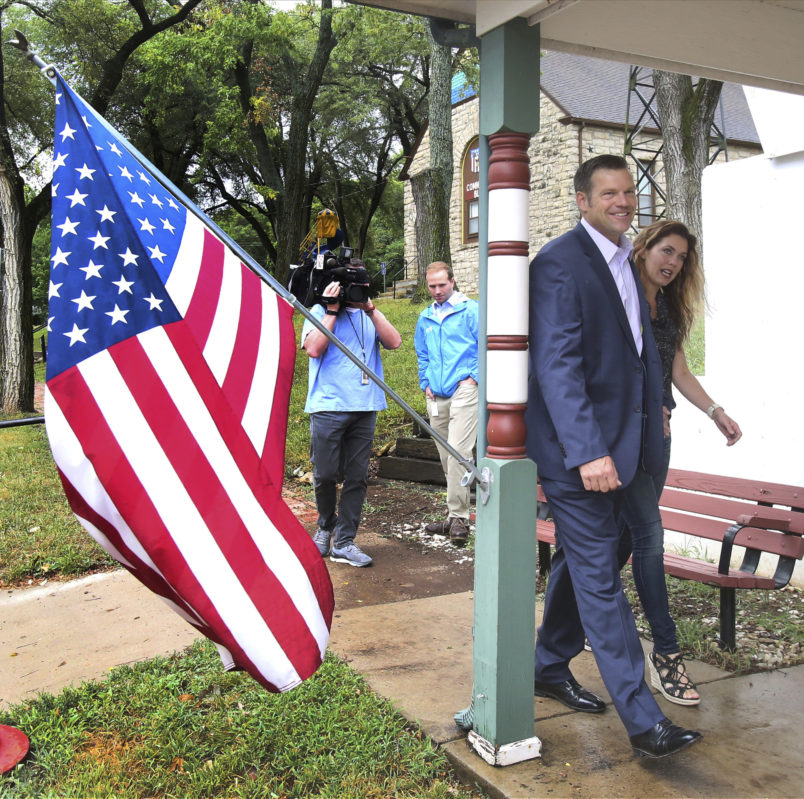 Kansas Secretary of State Kris Kobach and his wife Heather arrived to vote Tuesday morning, August 7th, 2018, at the Lecompton City Hall. Kobach is running for his party's nomination for governor. (AP Photo, Topeka Capital-Journal, Thad Allton)