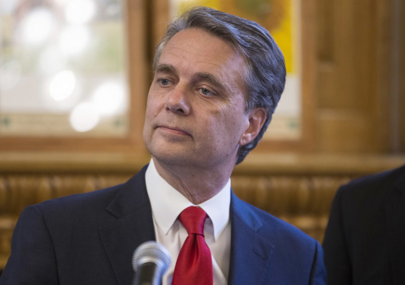 Kansas governor Jeff Colyer talks to reporters in Topeka, Kan., on Wednesday, Aug. 8, 2018, a day after his primary race against Kansas Secretary of State Kris Kobach. Colyer is currently 191 votes behind Kobach and is awaiting the results of mail-in and provisional ballots. (AP Photo/The Wichita Eagle, Travis Heying)