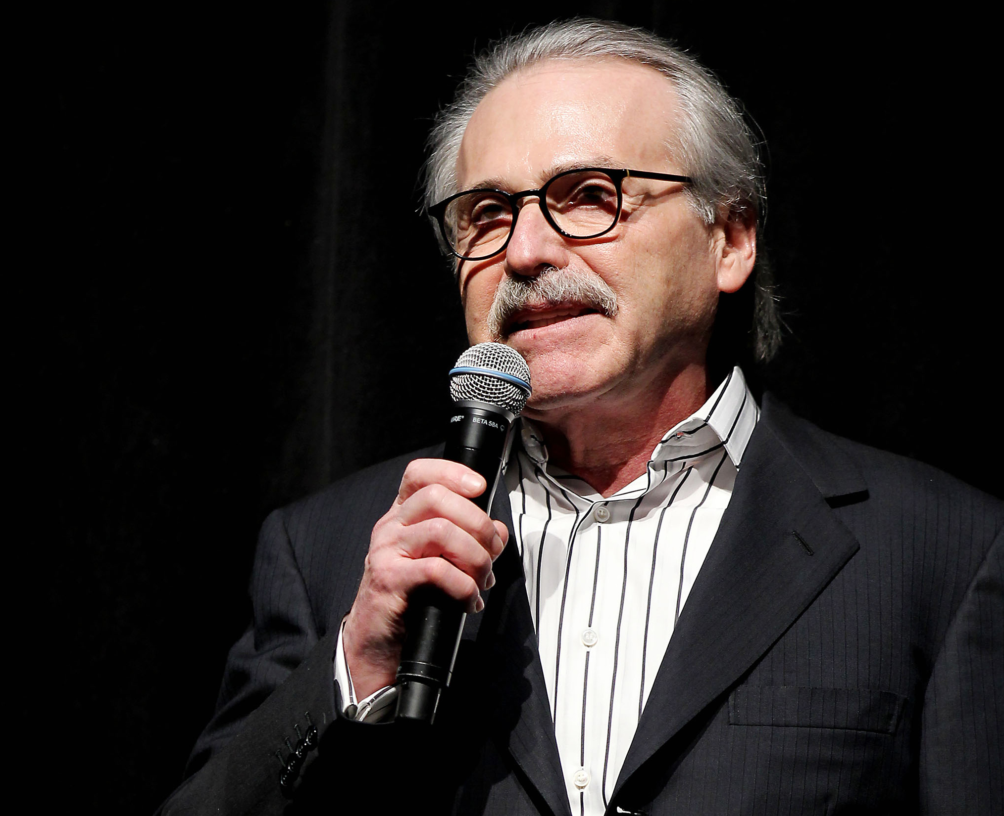 In this Jan. 31, 2014 photo David Pecker,  David Pecker, Chairman and CEO of American Media, addresses those attending the Shape & Men's Fitness Super Bowl Party in New York. The Aug. 21, 2018 plea deal reached by Donald Trump's former attorney Michael Cohen has laid bare a relationship between the president and Pecker, whose company publishes the National Enquirer. Besides detailing tabloid's involvement in payoffs to porn star Stormy Daniels and Playboy Playmate Karen McDougal to keep quiet about alleged affairs with Trump, court papers showed how David Pecker, a longtime friend of the president, offered to help Trump stave off negative stories during the 2016 campaign. (AP Photo/Marion Curtis)