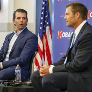 Donald Trump Jr., left, joins Kansas gubernatorial candidate Kris Kobach at a fundraising dinner at Noah's Event Venue in northeast Wichita, Kan. on Tuesday, July 17, 2018. (Fernando Salazar/Wichita Eagle/TNS)