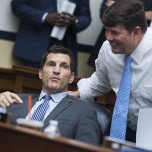 UNITED STATES - JULY 25: Reps. Scott Taylor, R-Va., left, and Steven Palazzo, R-Miss., House Appropriations Committee markup of the FY 2019 Homeland Security Appropriations Bill in Rayburn Building on July 25, 2018. (Photo By Tom Williams/CQ Roll Call)