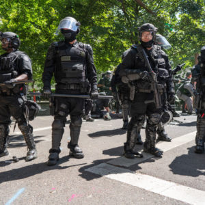 PORTLAND, OREGON, UNITED STATES - 2018/08/04: Police seen in downtown Portland during the Patriot Prayer Rally.The Proud Boys organized the Patriot Prayer Rally in Portland. The Proud Boys, a far right group supportive of President Donald Trump, used inflammatory language ahead of their rally, with some members promising violence. Counter-protesters led by Antifa confronted the participants of the Patriot Prayer Rally and clashed with police, leading to arrests and injuries. (Photo by Kainoa Little/SOPA Images/LightRocket via Getty Images)