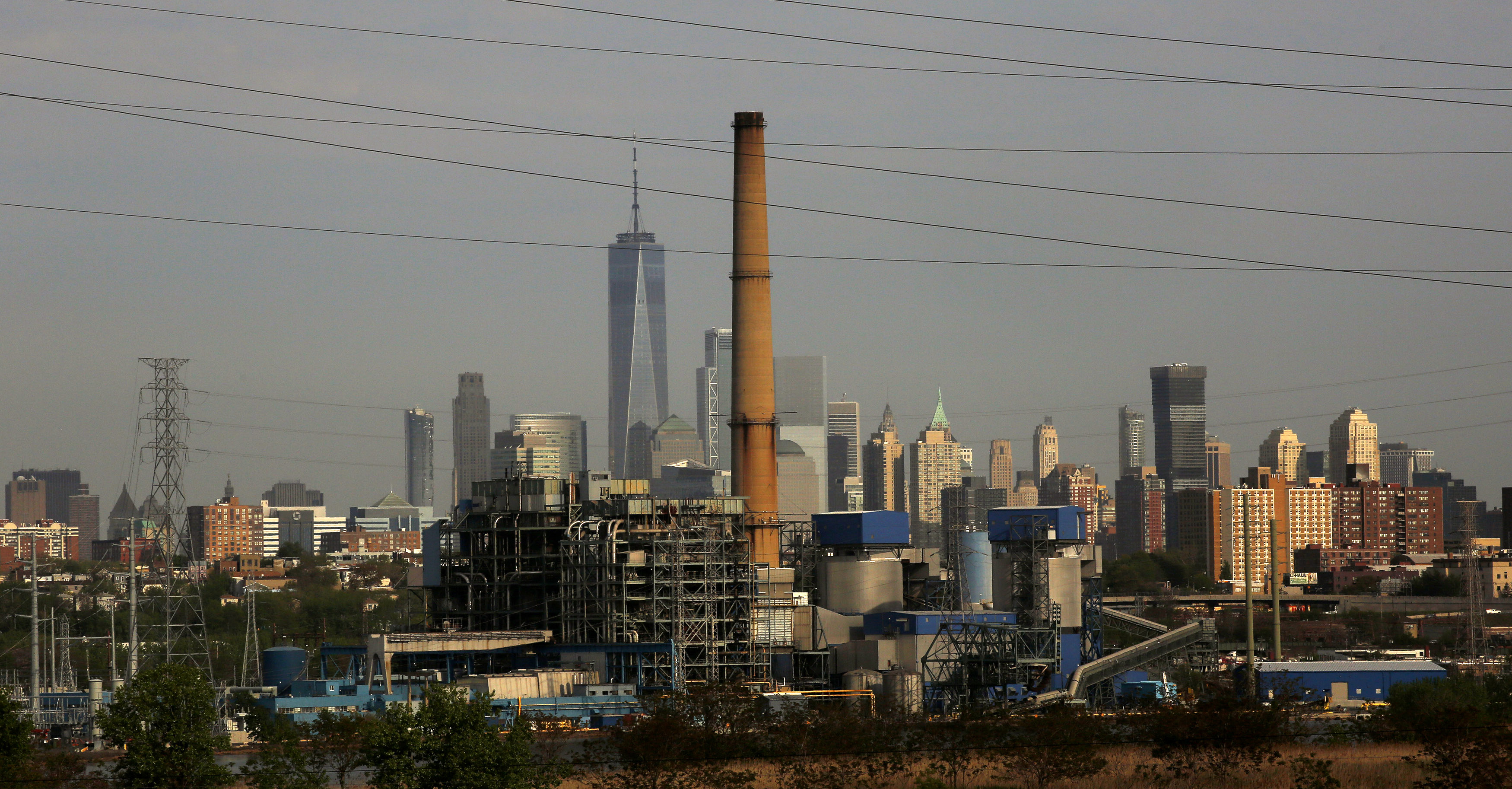 JERSEY CITY, NJ - MAY 10: The world trade center building is seen on the background of the Hudson Generating Station in Jersey City, New Jersey on May 10 2018. The U.S. Environmental Protection Agency (EPA) is opposing to the effort to repeal the historic climate change protection rule for power plants made by former President Barack Obama, Environmental Defense groups, are fighting back against the Trump administrationÕs request to delay the litigation over the Environmental Protection AgencyÕs (EPA) Clean Power Plan for another 60 days. (Photo by Kena Betancur/VIEWpress/Corbis via Getty Images)
