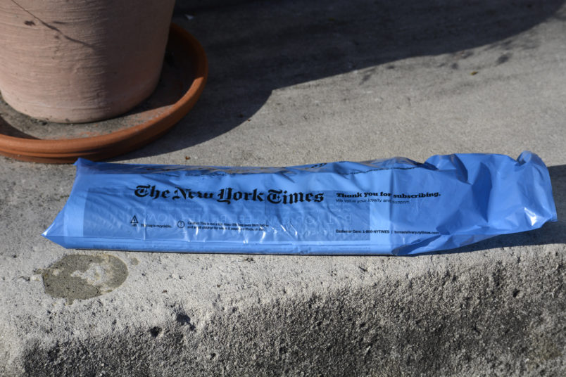 ALEXANDRIA, VA - APRIL 20, 2018:  A copy of a home-delivered New York Times sits on the front steps of a home in Alexandria, Virginia. (Photo by Robert Alexander/Getty Images)