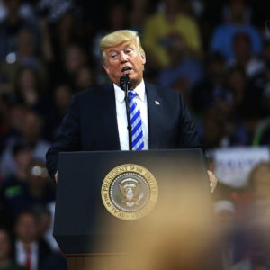 CHARLESTON, WV - AUGUST 21:  People cheer as President Donald Trump speaks at a rally on August 21, 2018 in Charleston, West Virginia. Paul Manafort, a former campaign manager for Donald Trump and a longtime political operative, was found guilty of eight financial crimes Tuesday in a Washington court. In further developments for the president, his former lawyer, Michael Cohen, has plead guilty in New York as part of a separate deal withÊprosecutors.  (Photo by Spencer Platt/Getty Images) *** Local Caption *** Donald Trump