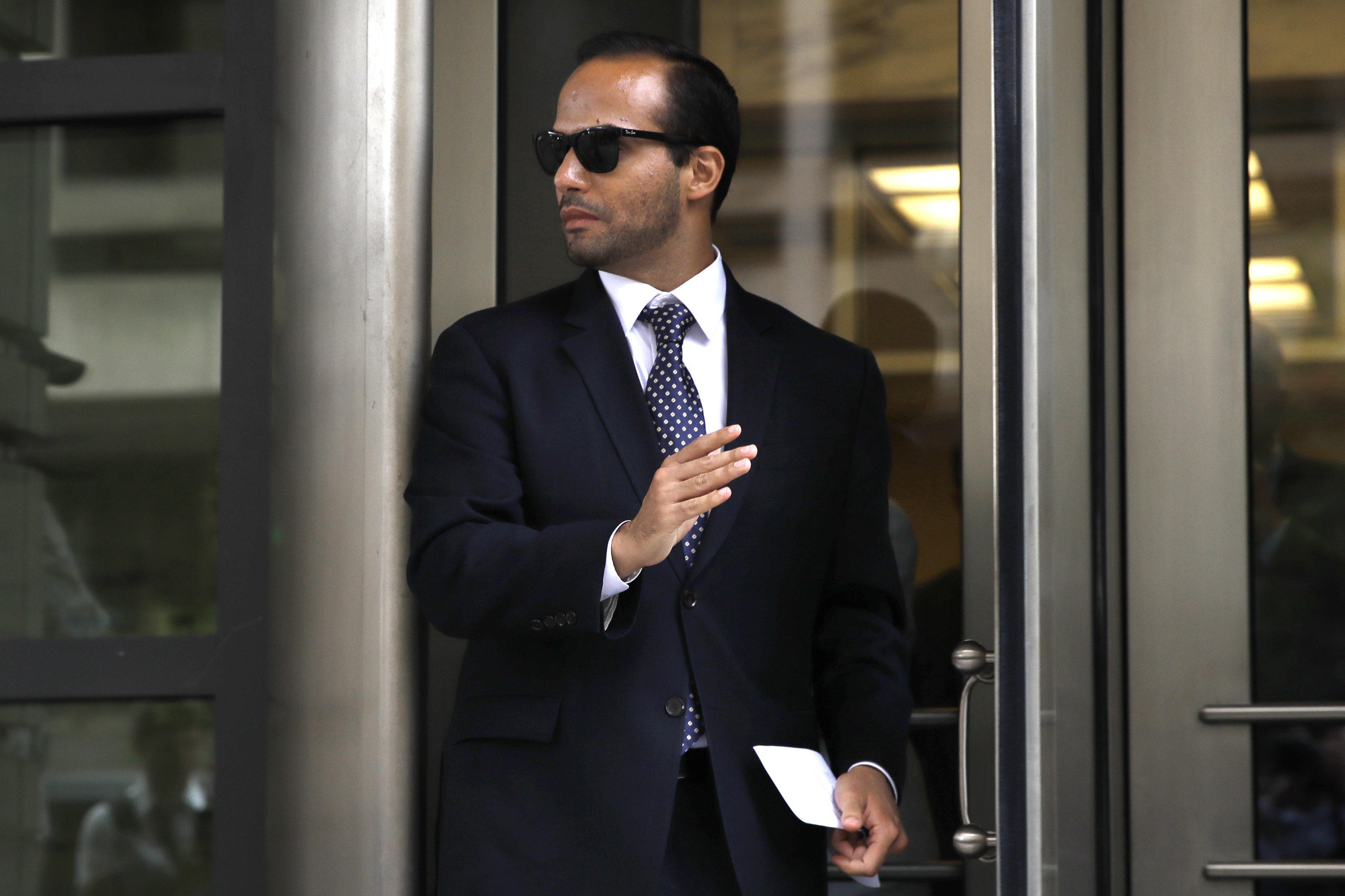 Former Donald Trump presidential campaign foreign policy adviser George Papadopoulos, who triggered the Russia investigation, and who pleaded guilty to one count of making false statements to the FBI, leaves federal court after he was sentenced to fourteen days in prison, Friday, Sept. 7, 2018, in Washington. (AP Photo/Jacquelyn Martin)