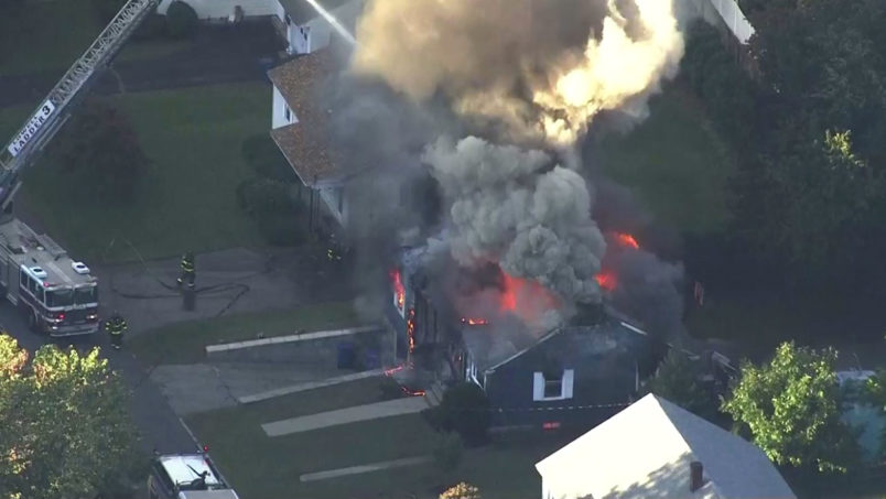 In this image take from video provided by WCVB in Boston, firefighters battle a raging house fire in Lawrence, Mass, a suburb of Boston, Thursday, Sept. 13, 2018. Emergency crews are responding to what they believe is a series of gas explosions that have damaged homes across three communities north of Boston. (WCVB via AP)