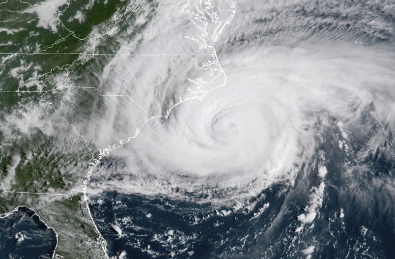 Dead, 'Catastrophic Flooding' as Florence Hovers Over Carolinas