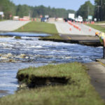 Flooding from Sutton Lake has washed away part of U.S. 421 in New Hanover County just south of the Pender County line in Wilmington, N.C., Friday, September 21, 2018.  [Matt Born/StarNews Photo]