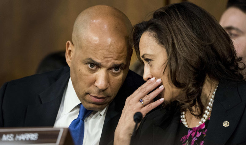 WASHINGTON, DC - Senators Corey Booker (D-NJ) and Kamala Harris (D-CA) speak quietly during Supreme Court nominee Brett Kavanaugh's confirmation hearing in the Senate Judiciary Committee on Capitol Hill in Washington, DC on Tuesday September 4, 2018. (Photo by Melina Mara/The Washington Post)