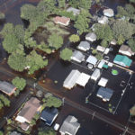 LUMBERTON, NC - SEPTEMBER 20:  Flood waters are seen surrounding homes after heavy rains from Hurricane Florence on September 20, 2018 in Lumberton, North Carolina. Residents have begun cleaning up in North Carolina as the flooding has begun to subside.  (Photo by Joe Raedle/Getty Images)