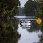LONGS, SC - SEPTEMBER 21: A disabled car is surrounded by floodwaters caused by Hurricane Florence near the Todd Swamp on September 21, 2018 in Longs, South Carolina. Floodwaters are expected to rise in the area in through the weekend. (Photo by Sean Rayford/Getty Images)