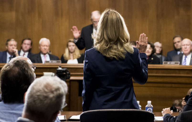 WASHINGTON, DC - SEPTEMBER 27: Dr. Christine Blasey Ford is sworn in by chairman Chuck Grassley, R-Iowa, on Capitol Hill September 27, 2018 in Washington, DC. A professor at Palo Alto University and a research psychologist at the Stanford University School of Medicine, Ford has accused Supreme Court nominee Judge Brett Kavanaugh of sexually assaulting her during a party in 1982 when they were high school students in suburban Maryland. (Photo By Tom Williams-Pool/Getty Images)