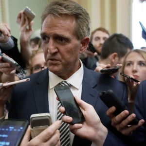 WASHINGTON, DC - SEPTEMBER 28:  U.S. Sen. Jeff Flake (R-AZ) speaks to members of the media after a meeting in the office of Senate Majority Leader Sen. Mitch McConnell (R-KY) September 28, 2018 at the U.S. Capitol in Washington, DC. President Donald Trump has ordered a one-week-long supplemental FBI background investigation into sexual assault allegations made against Supreme Court nominee Judge Brett Kavanaugh after Sen. Flake requested to delay the full Senate vote for the investigation.  (Photo by Alex Wong/Getty Images) *** Local Caption *** Jeff Flake