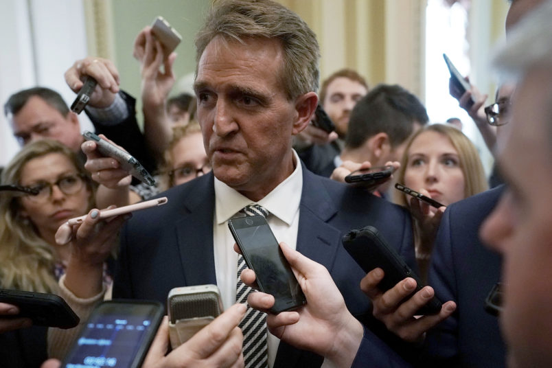 Flake casts key vote but asks for Federal Bureau of Investigation inquiry