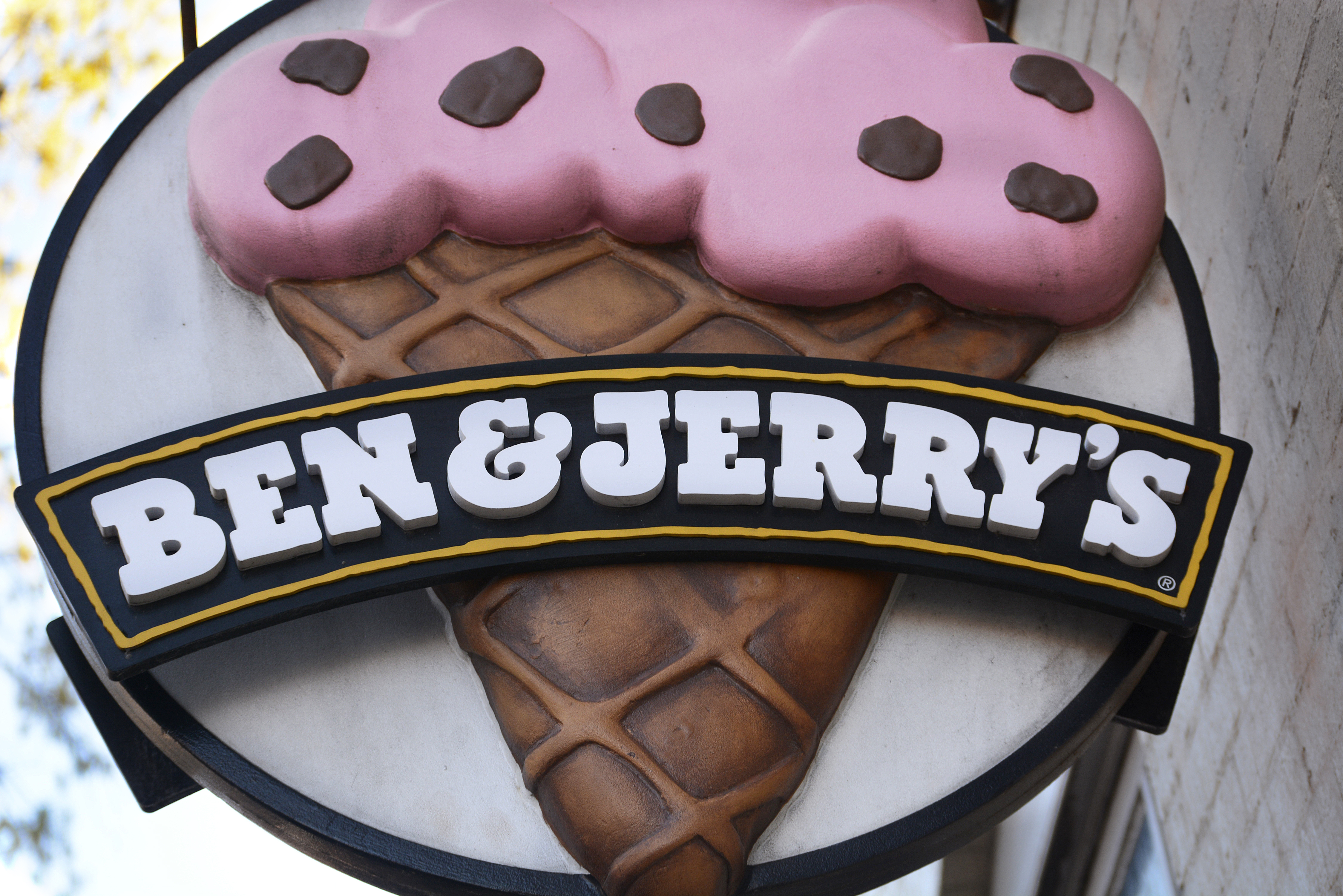 ALEXANDRIA, VA - APRIL 20, 2018:  A business sign hangs over the entrance to a Ben & Jerry's ice cream shop in the Old Town section of Alexandria, Virginia. (Photo by Robert Alexander/Getty Images)