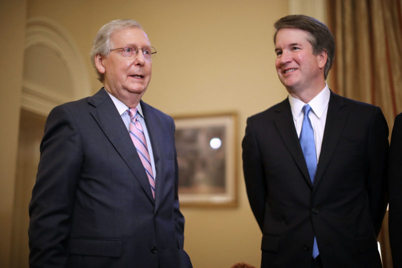 Judge Brett Kavanaugh poses for photographs with Vice President Mike Pence and Senate Majority Leader Mitch McConnell (R-KY) before a meeting in McConnell's office in the U.S. Capitol July 10, 2018 in Washington, DC. U.S. President Donald Trump nominated Kavanaugh to succeed retiring Supreme Court Associate Justice Anthony Kennedy.
