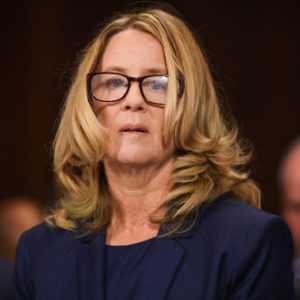 Christine Blasey Ford, the woman accusing Supreme Court nominee Brett Kavanaugh of sexually assaulting her at a party 36 years ago, testifies during his US Senate Judiciary Committee confirmation hearing on Capitol Hill in Washington, DC, September 27, 2018. (Photo by SAUL LOEB / POOL / AFP)        (Photo credit should read SAUL LOEB/AFP/Getty Images)
