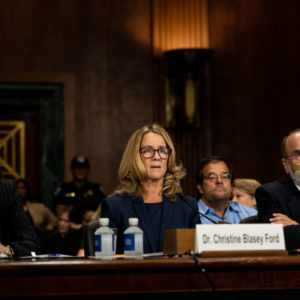 WASHINGTON, DC - SEPTEMBER 27:   Christine Blasey Ford listens to opening statements prior to testifying before the Senate Judiciary Committee at the Dirksen Senate Office Building on Capitol Hill September 27, 2018 in Washington, DC. Blasey Ford, a professor at Palo Alto University and a research psychologist at the Stanford University School of Medicine, has accused Supreme Court nominee Brett Kavanaugh of sexually assaulting her during a party in 1982 when they were high school students in suburban Maryland.  (Photo by Erin Schaff-Pool/Getty Images)