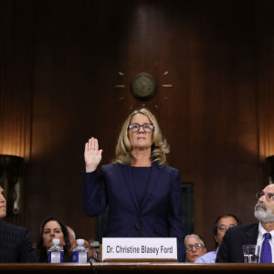 WASHINGTON, DC - SEPTEMBER 27:  Christine Blasey Ford (C) is sworn in before testifying the Senate Judiciary Committee with her attorneys Debra Katz (L) and Michael Bromwich (R) in the Dirksen Senate Office Building on Capitol Hill September 27, 2018 in Washington, DC. A professor at Palo Alto University and a research psychologist at the Stanford University School of Medicine, Ford has accused Supreme Court nominee Judge Brett Kavanaugh of sexually assaulting her during a party in 1982 when they were high school students in suburban Maryland. In prepared remarks, Ford said, ?I don?t have all the answers, and I don?t remember as much as I would like to. But the details about that night that bring me here today are ones I will never forget. They have been seared into my memory and have haunted me episodically as an adult.?  (Photo by Win McNamee/Getty Images)