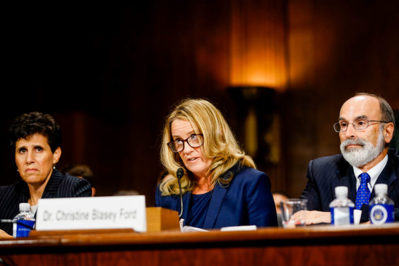 WASHINGTON DC- SEPTEMBER 27 Christine Blasey Ford with lawyers Debra S. Katz left and Michael R. Bromwich answers questions at a Senate Judiciary Committee hearing in the Dirksen Senate Office Building on Capitol Hill