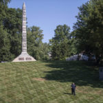 PLEASE HOLD FOR STORY SLUGGED CONFEDERATE CEMETERIES SECURITY BY JIM SALTER -  In this photo made Wednesday, Sept. 19, 2018, a security guard walks the grounds at North Alton Confederate Cemetery in Alton, Ill. The federal government has hired private security firms to guard several Confederate memorials across the U.S in the aftermath of clashes between white nationalists and counter-protesters last year. Information obtained by The Associated Press shows that nearly $3 million has been spent on contracted security since last summer and another $1.6 million is budgeted for similar protection in fiscal 2019. (AP Photo/Jeff Roberson)